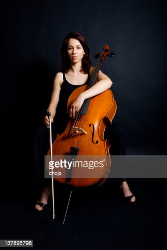 Beautiful woman cellist with her instrument