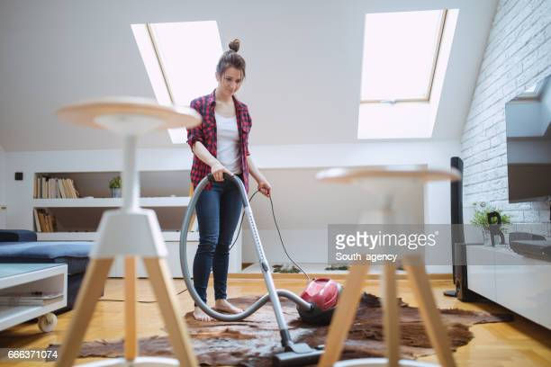 Beautiful woman cleaning the house