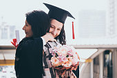 Beautiful woman congratulates for her daughter on graduation day, Successful concept