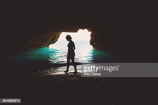 Beautiful woman contemplating from inside the stunning secret cave similar images sciox Choice Image