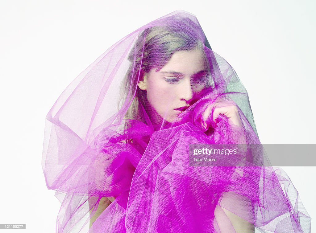 beautiful woman covered with bright pink material