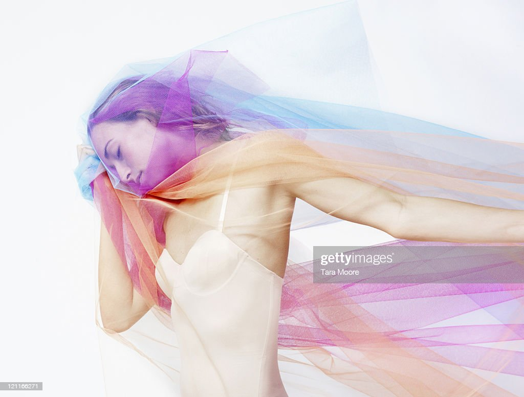 beautiful woman covered with colored material : Stock Photo