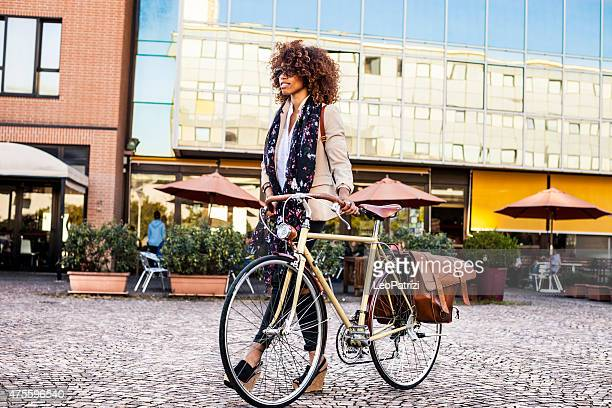 Beautiful woman cycling in the city