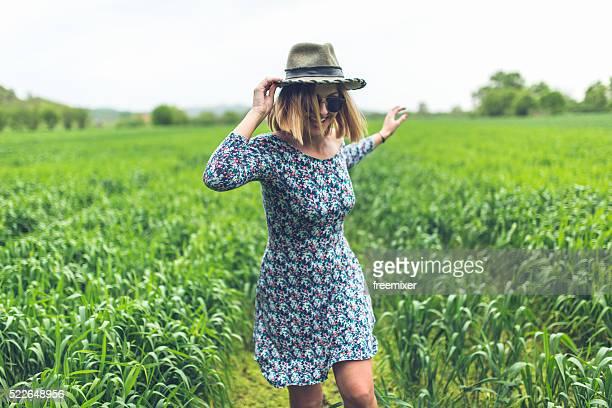 Beautiful woman dancing in a field