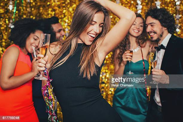 Beautiful woman dancing on a formal party