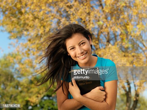 Beautiful woman embracing the Bible