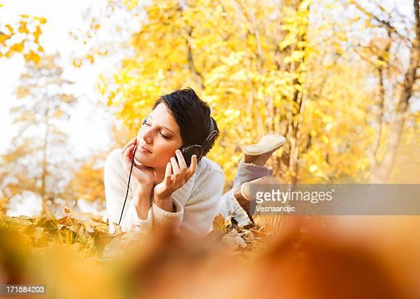 Beautiful woman enjoying in autumn
