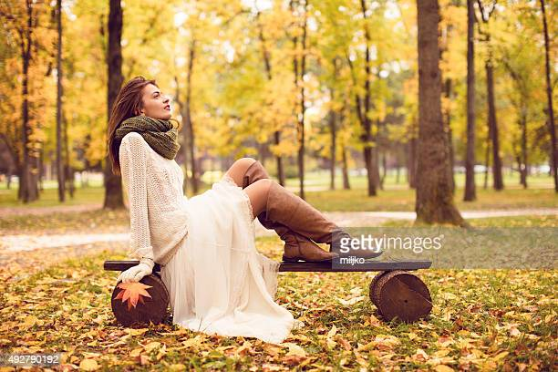 Beautiful woman enjoying in autumn