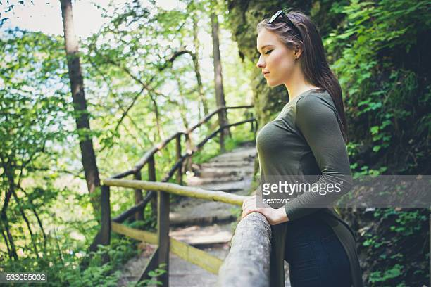 beautiful woman enjoying nature in green forest