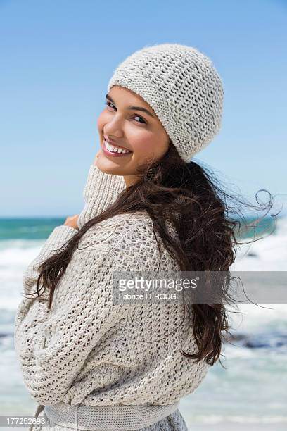Beautiful woman enjoying on the beach in winter
