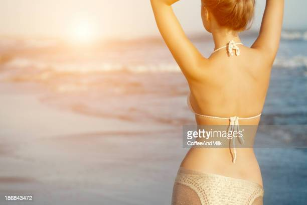 Beautiful woman enjoying sun on the beach
