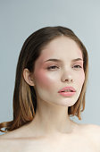 Beauty Woman with perfect healthy skin Portrait. Beautiful  Girl Spa model, pampering her skin.