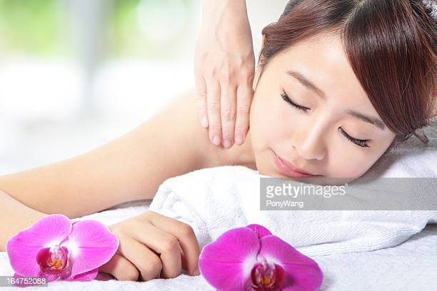 beautiful woman getting spa massage on shoulder