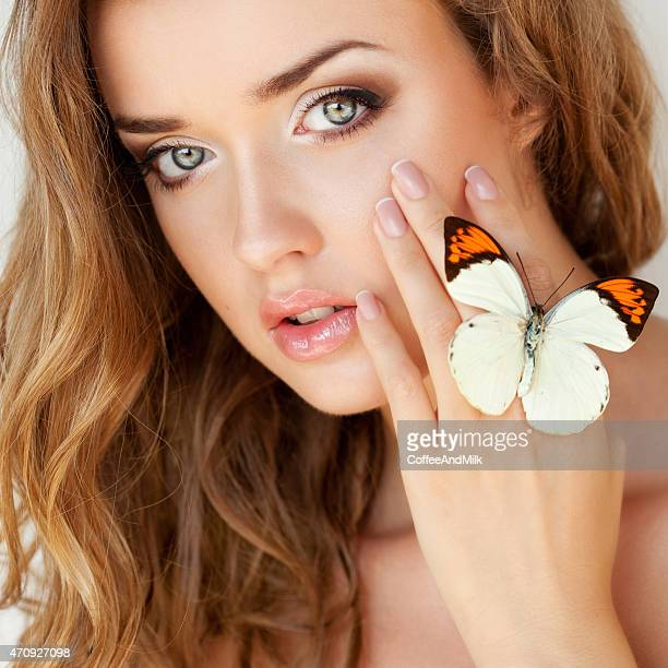 Beautiful woman holding a butterfly