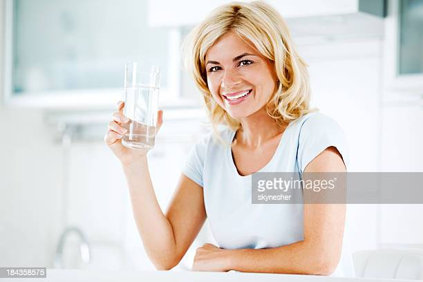 Beautiful woman holding a glass of water.