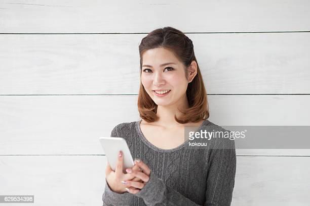 Beautiful woman holding a smartphone