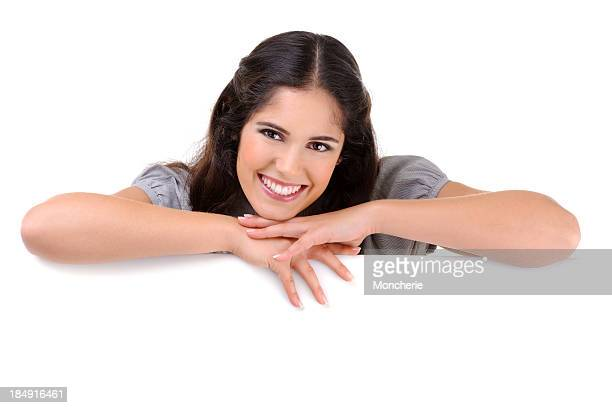 Beautiful woman holding a white billboard