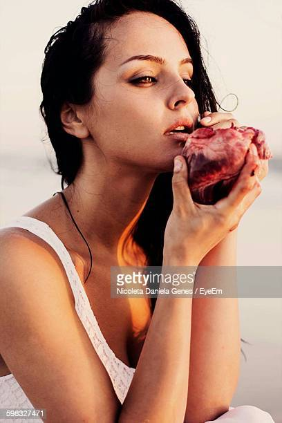 Beautiful Woman Holding Heart