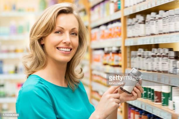 Beautiful Woman Holding Pill Bottle