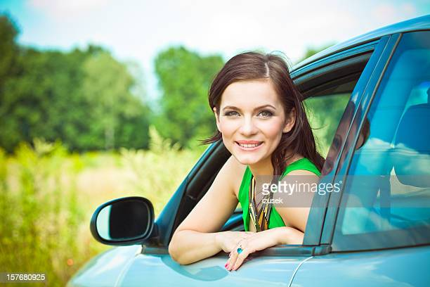 Beautiful woman in a car