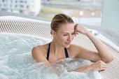Beautiful woman in a hot tub