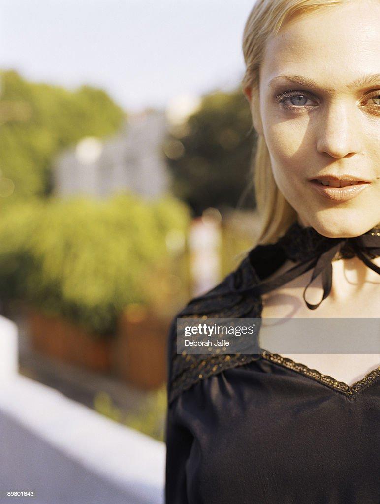 Beautiful woman in black dress : Stock Photo
