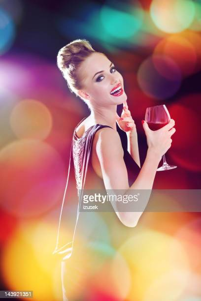 Beautiful woman in colorful spotlights