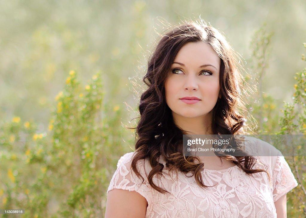 Beautiful woman in field : Stock Photo