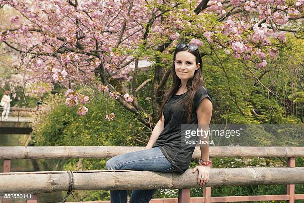 Beautiful woman in front of a cherry tree, Kyoto