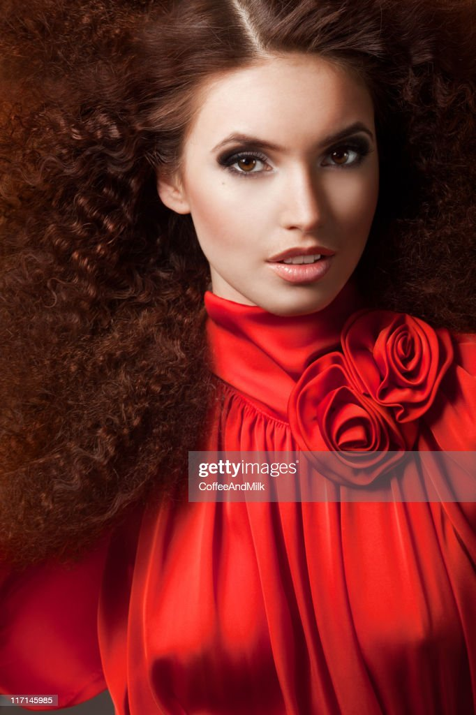 Beautiful woman in red dress : Stock Photo