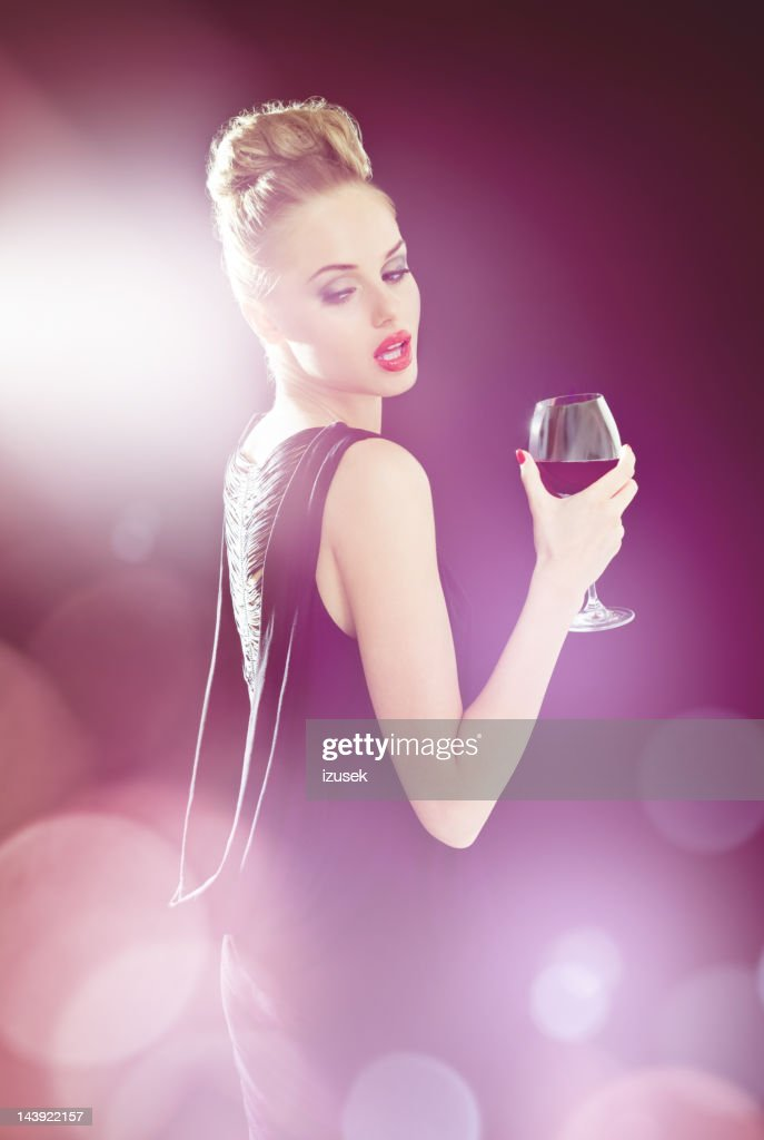 Beautiful woman in spotlights : Stock Photo