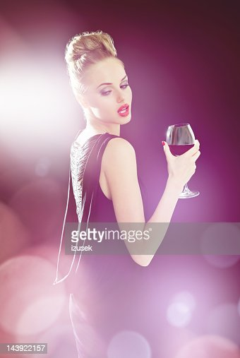Beautiful woman in spotlights : Stock Photo