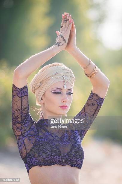 Beautiful woman in sunrise lights doing yoga exersices