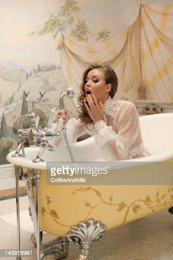 Beautiful woman in the bathroom : Stock Photo