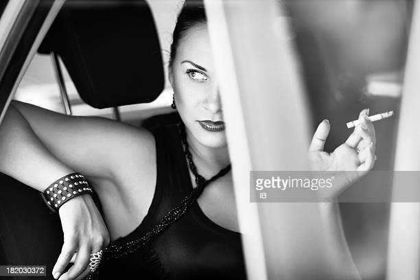 Beautiful woman in the car looks with contempt