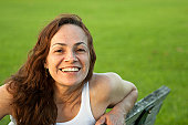 Beautiful woman smiling and looking straight to camera at park