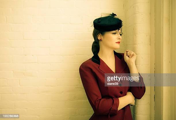 Beautiful woman in vintage forties clothing
