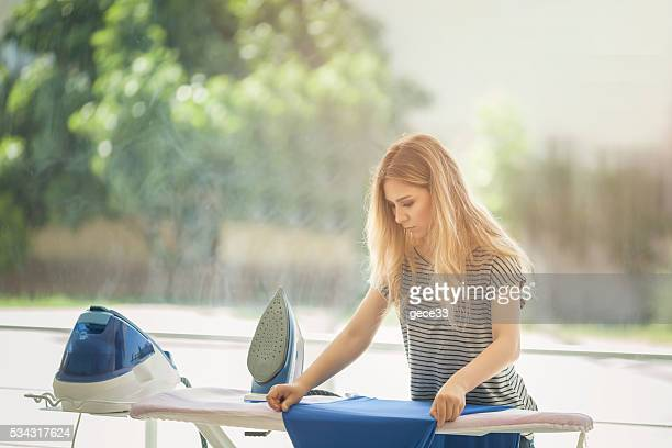 beautiful woman ironing some clothes