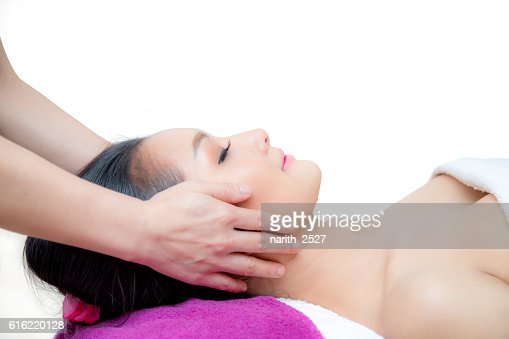 Beautiful woman is getting a facial massage : Photo