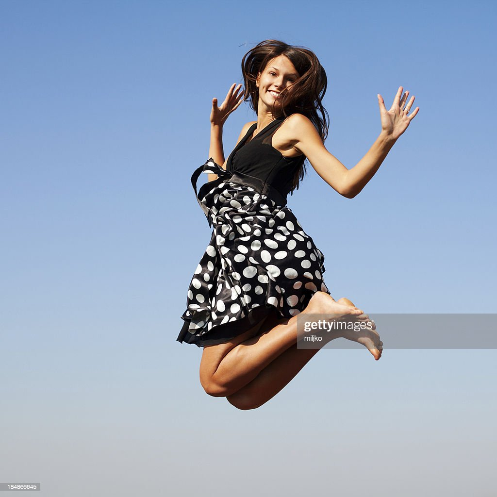 Beautiful woman jumping outdoors