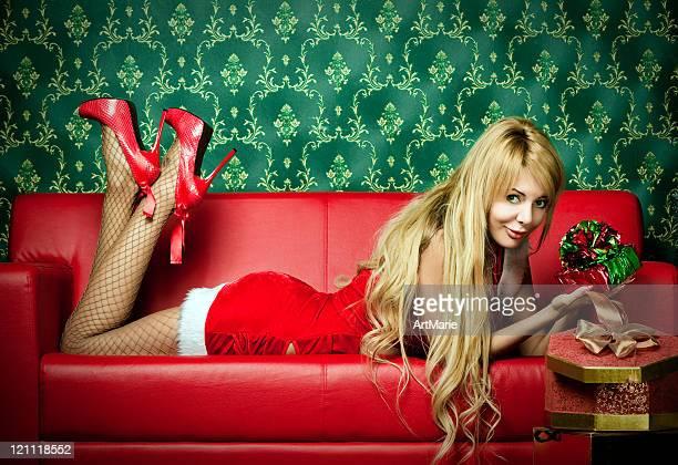 Beautiful woman laying on a sofa