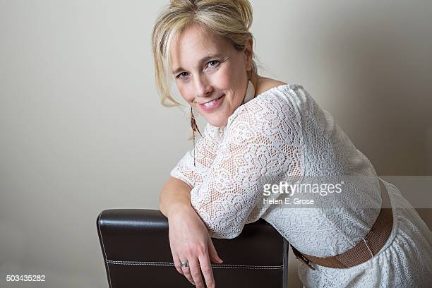 A beautiful woman leaning on her elbows, looking at the camera