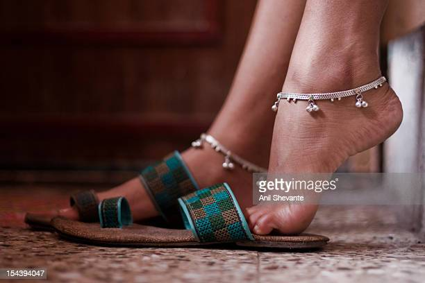 Beautiful woman legs with anklet and footwear