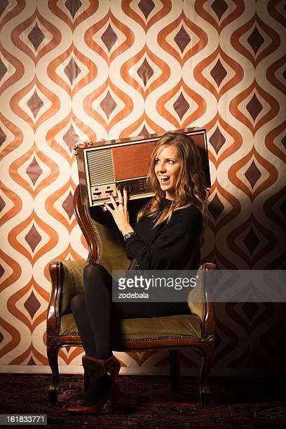 Beautiful Woman Listening Music on Vintage Radio