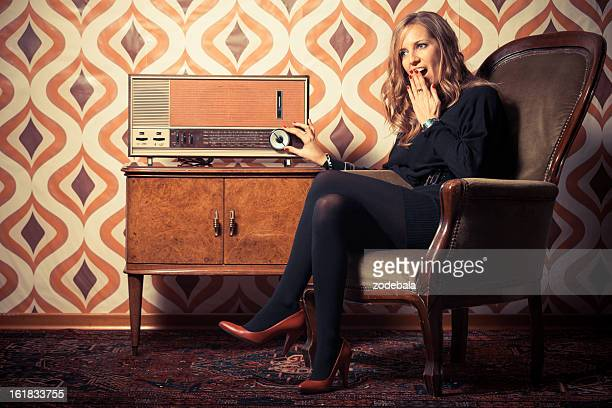 Beautiful Woman Listening News on Vintage Radio