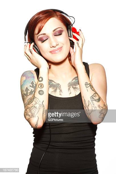 Beautiful Woman Listening to Music on Red Headphones