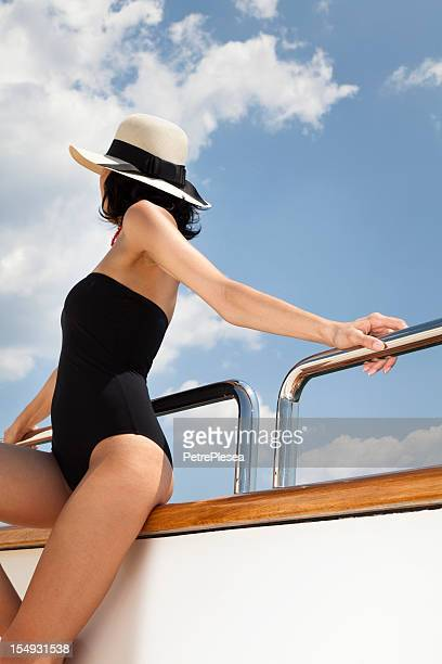 Beautiful woman looking at the sea on a luxury yacht