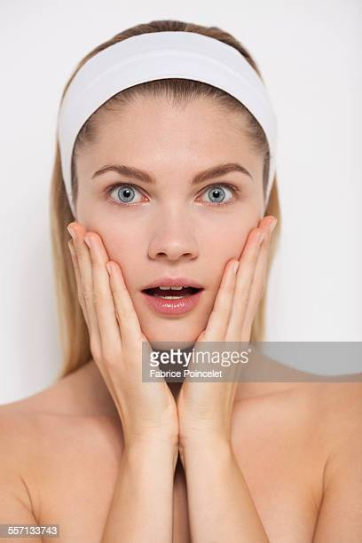 Beautiful woman looking surprised