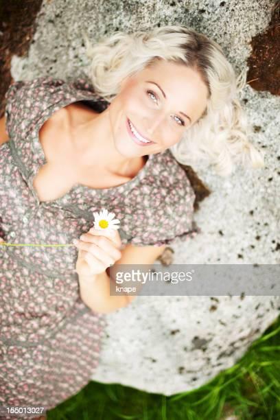 Beautiful woman lying on a rock