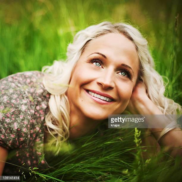 Beautiful woman lying on grass